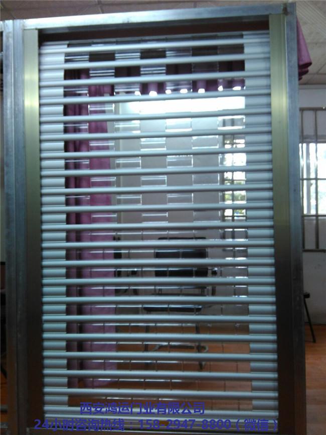 西安电动水晶卷帘门安装 西安电动水晶卷帘门定做-- 西安鸿运门业有限公司